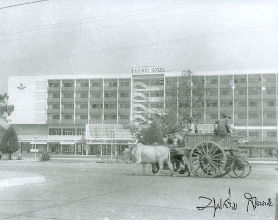 Oxcarts in front of railway hotel