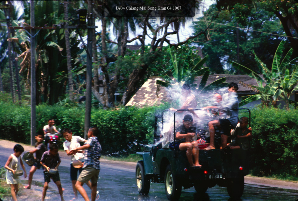 Dousing a jeep, Songkran 1967. Picture by Phil Bradbeer.