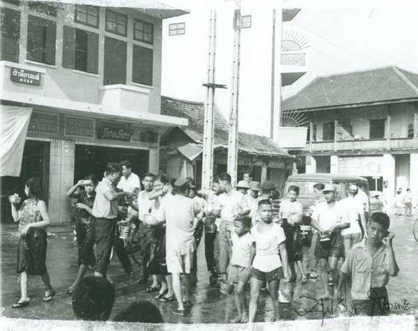 Songkran. The Yong Chiang building on the right. Picture by Boonserm Satrabhaya.