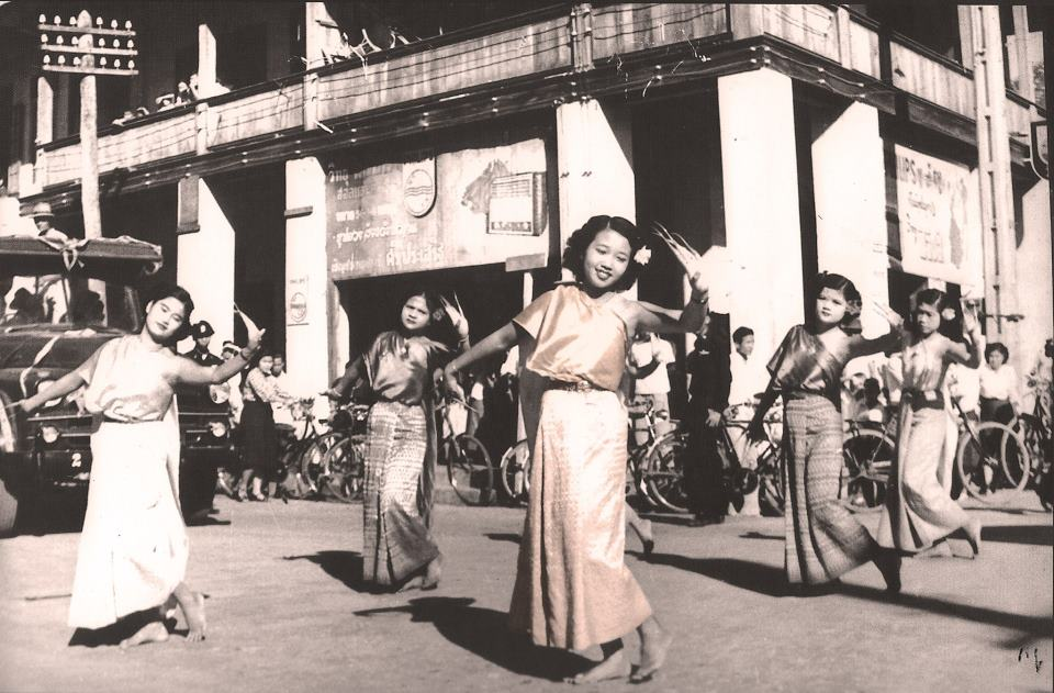 Dancing in front of the Yong Chiang huilding. Source unknown. Date unknown.