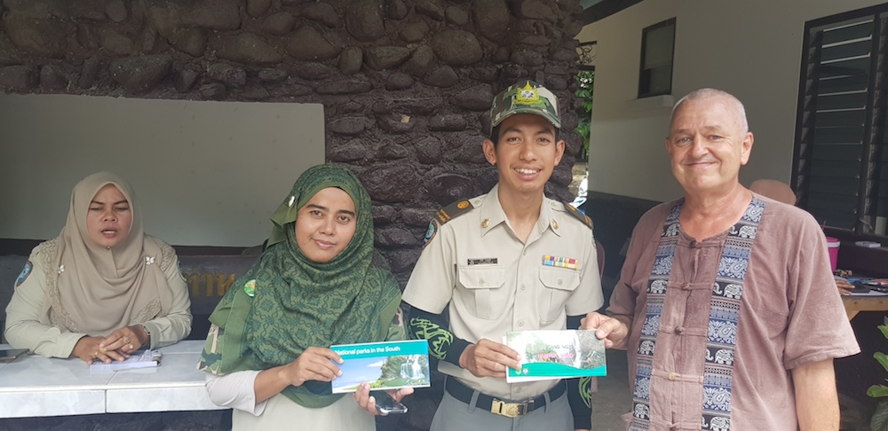 National park staff hands over the brochure of Budo Sungai Padi National park to Frans Betgem