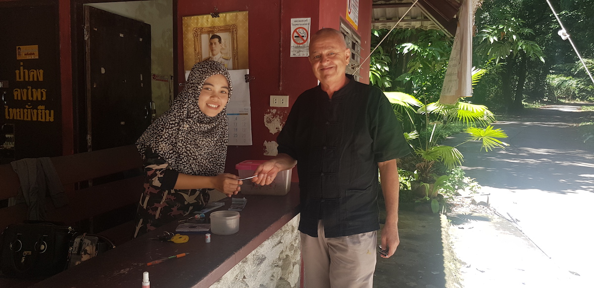 Frans Betgem buys a ticket for the Thanto Waterfall in Bang Lang National Park