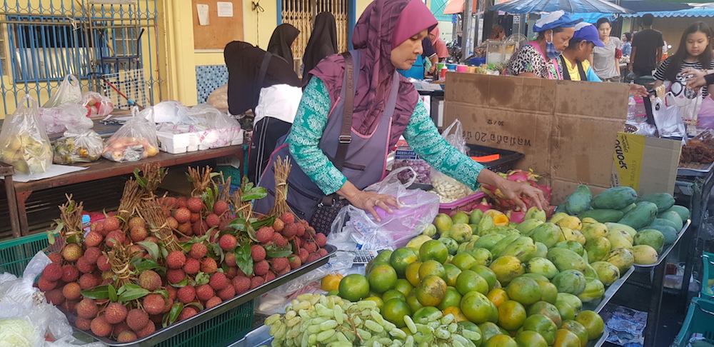 Buying the first lychees of the season at the market in Pattani