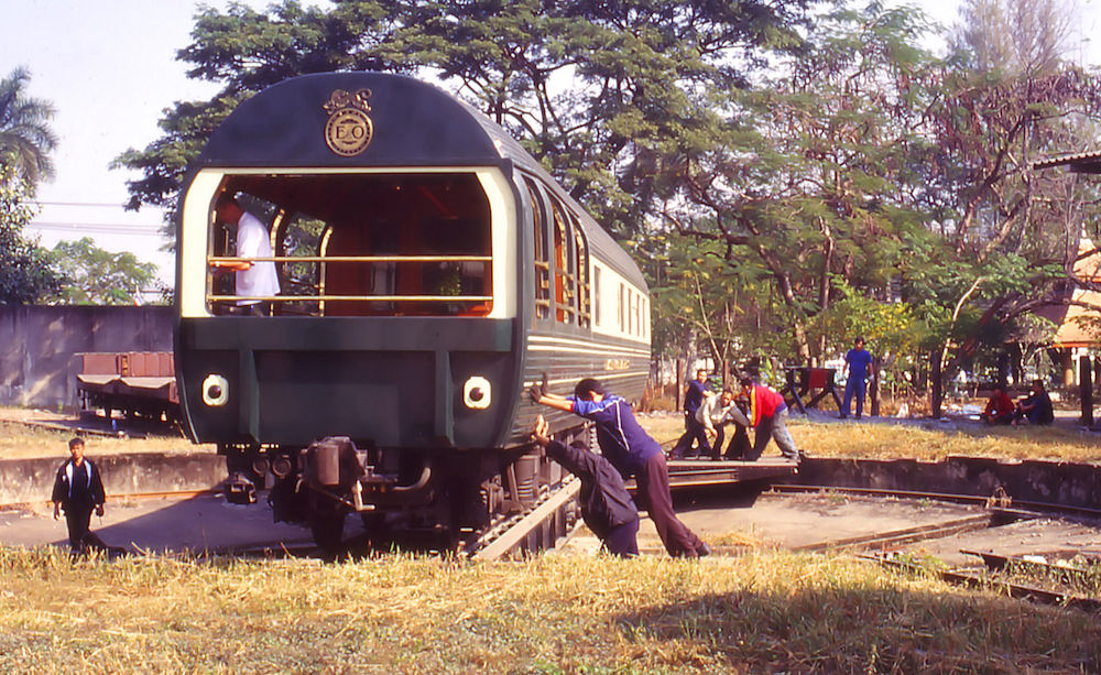 Train staff pushing a carriage on the turntable