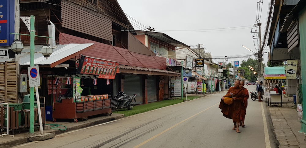 Monks in the main street in Pai in the early morning