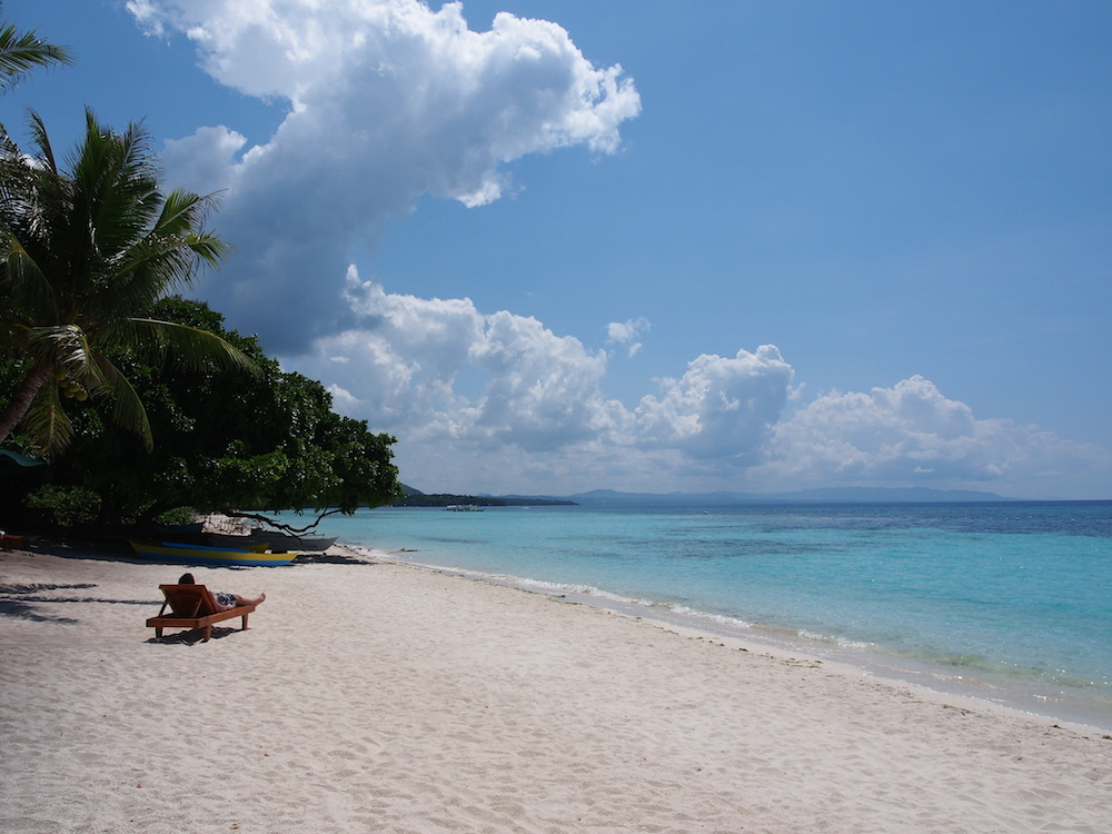 Tourist sunbathing on Panglao Beach Bohol