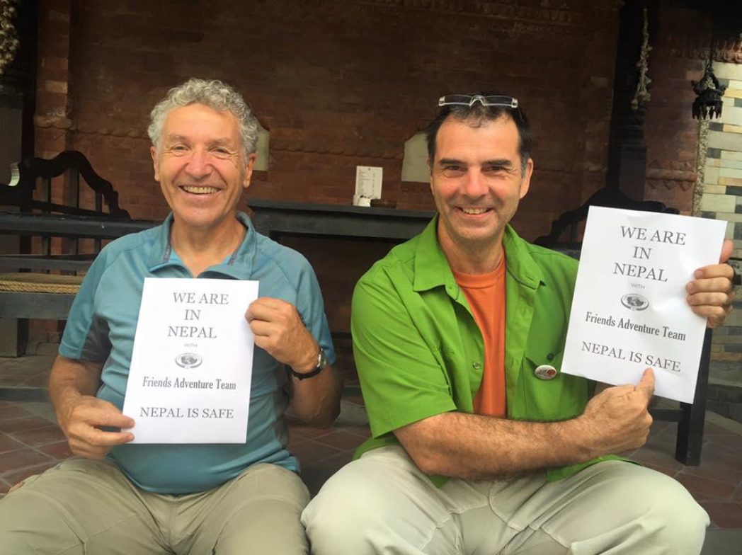 Two foreigners holding a sign We are in Nepal